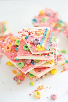 Make a little edible magic for your toddler's birthday party with this Magical Rainbow Unicorn Candy Bark recipe. Packed with fruity cereal, colorful sprinkles, and sour candy, this loaded yogurt bark is the ideal kid-friendly party treat!