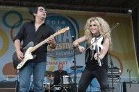 Natalie Stovall & The Drive perform on the BMI Tailgate Party outside LP Field during the CMA Festival on June 7, 2014, in Nashville, TN.