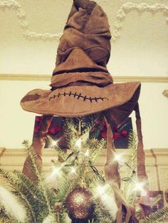 Sorting hat tree topper...... YES. This makes me nerdy, I know. Embrace it. Also, if this bothers you, shush. The only nerdy thing on this board. <3