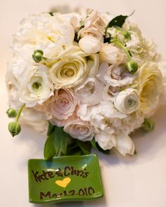Ms. Pencils' May wedding bouquet of pale and white ranunculus, peonies and roses with green foliage accents.