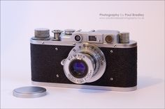 https://flic.kr/p/cyWyFo | FED-1 | A Russian FED-1 (G), a mid-fifties copy of the classic 1930's Leica 35mm. The FED-1 included the telescoping Industar lens, copied directly from the Elmar on the Leica (though not in actual element layout), which was replaced on later versions. This one has a misaligned rangefinder, sadly.
