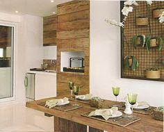Varanda com churrasqueira ligada à cozinha gourmet