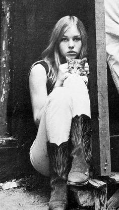 Michelle Phillips of the Mamas and the Papas with a cat