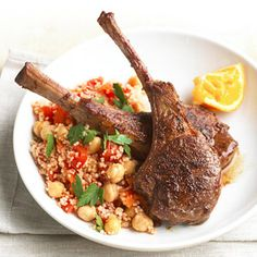 Use this orange peel and cinnamon rub recipe to spice up these skillet lamb chops. Top with couscous and veggie mixture.