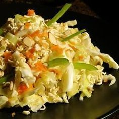 In this salad, shredded green cabbage is tossed with dried ramen noodles and nuts in a simple sweet and sour vinaigrette.