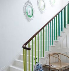 Beautiful painted staircase in rainbow of green and blue