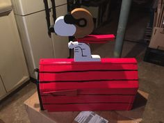 Red mailbox designed like Snoopy as the Red Baron. We can make this with Woodstock or without Woodstock. Your house number or name can be painted on the side of the mailbox also. We can add bullet holes also