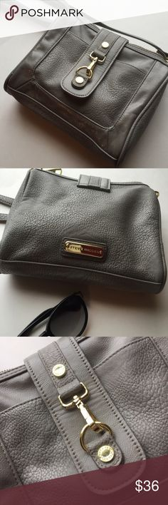 Steve Madden Crossbody Bag Adorable and functional grey crossbody by Steve Madden! Features gold hardware and snap closure. Great condition, no noticeable damage but the leather is soft from normal wear. Steve Madden Bags Crossbody Bags