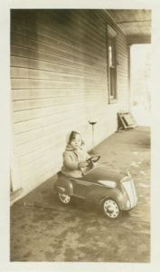 Black and white antique pedal car
