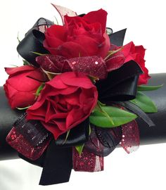 Red and black wrist corsage by Ballard Blossom. Prom flowers, Seattle
