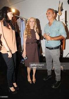Guest, Vogue Italia editor-in-chief Franca Sozzani and designer Alessandro dell'Acqua attend the N 21 Spring/Summer 2012 fashion show as part of Milan Womenswear Fashion Week on September 21, 2011 in Milan, Italy.