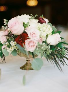 Gorgeous Low and Lush Wedding Centerpiece with Blushes, Wines, Whites, and Greenery // gold pedestal, roses, hydrangea, ruscus