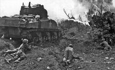 US Marines attack a Japanese bunker on Okinawa with an M4 Sherman flamethrower tank of the 713th Flamethrower Tank Battalion, May 1945.
