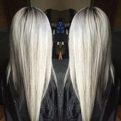 Equal parts of Redken Shades Eq 9V, 9T and 9B with processing solution.
