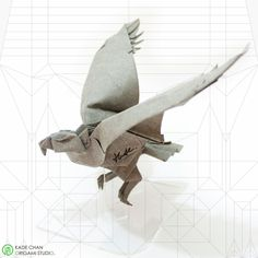 Eagle 2013 Designed by : Kade Chan 2013 50x50cm single piece of uncut square paper, Completed model : 25cm, Time spent : 5 hours, Wet-folding + MC cover. Copyright © 2013 Chan Pak Hei, Kade http://kadechan.wix.com/portfolio