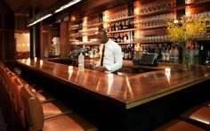 Blue Ribbon Sushi Bar & Grill's intimate bar at 6 Columbus in Midtown New York City.