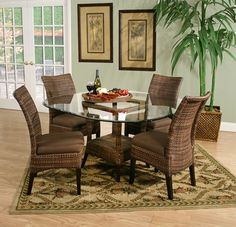 "The Denton dining collection features a table base of handcrafted naturally beautiful and sturdy rattan with a mahogany frame and finished in a cigar brown and a 54"" 12MM  glass top.  The collection includes 4 woven rattan dining chairs with a fixed seat cushion in a brown canvas."