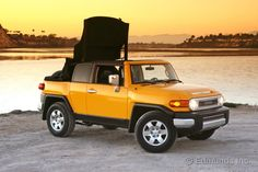 The Toyota FJ Cruiser gets even better if you slice off the top and turn it into a big, yellow beach cruiser, just like Newport Convertible Engineering does. Fj Cruiser Mods, 2007 Toyota Fj Cruiser, 4x4, Jeep Rubicon, Education Humor, Rear Wheel Drive, Toyota Hilux, Celebrity Travel, Travel Design