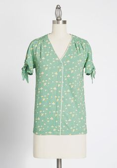 When comfort and playful design merge, the fashion stars must be aligned! Made from breathable cotton, this ModCloth-exclusive green blouse is decked in a daisy motif, along with a V-neckline and tie closures at the short sleeves. Wear this t Occasion Maxi Dresses, Green Blouse, Cotton Blouses, Top Pattern, Modcloth, Star Fashion, Plus Size Outfits, High Waisted Skirt, Short Sleeves