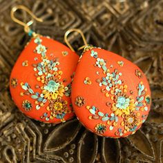 big bold bohemian earrings.  slabs of tomatoe red clay with splashes of aqua and gold detail  carved around vintage rhinestones.