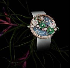 #Cartier The Frog #watch (limited to 40 pieces) combines gold, diamonds, sapphires, moonstones and emeralds