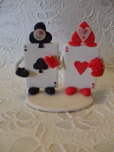 Alice in wonderland cards bride and groom wedding cake topper. $110.00, via Etsy.