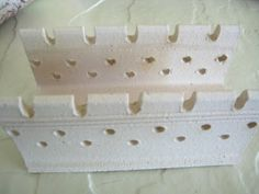 I like this image for inspiration to create some new bead holders for the kiln.