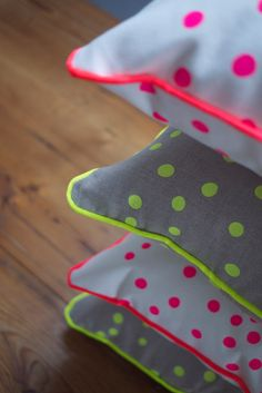 Neon Yellow and Pink Spot Linen Cushion. September Designs via Etsy.