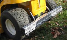 The Tarp Tow® System Is like having a 20' trailer hidden in your garage on demand and ready to be used for your yard work or storm clean up needs by just adding a plastic sheet to your riding lawn mower. It is a patented device that is built strong as a tank with a lifetime warranty. It attached in about 15 minutes and can be left attached because it only adds inches in length, allowing easy storage. Try doing that with a garden trailer! Go to www.tarptow.com for more information.