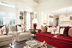 red couch, coral pillows.