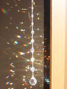 Hang crystals, faceted glass and sun catchers in the windows of your house to deflect unwanted energy and to create dancing rainbow colors in your home