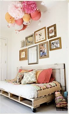 Love the clustered lanterns/pom pom balls.  For a party or a kids room.