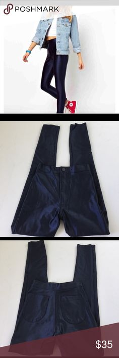 American Apparel Disco Pants, size XS American Apparel Disco Pants in size XS. Color is Midnight Navy Blue. Flat lay measure of the waist is 11.25, rise is 10.25, inseam is 27.5, and leg opening is 4.5. Made from 100% nylon. Please look at all photos and ask if you have any questions. American Apparel Pants