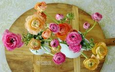 Simply Suzanne's AT HOME: a Spring-inspired table . . . ranunculus, grass, and hand-blown brown eggs