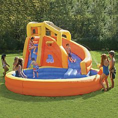 Typhoon Twist Inflatable Water Slide with Pool: Turn your backyard into the most popular place on the block! Our inflatable Banzai ™ water slide delivers oceans of fun, with a thrilling slide, climbing wall, water cannon, and basketball hoop. Plus, unlike many weve tried, its attached to an oversized swimming pool! Super sturdy construction. Inflates in less than 2 minutes; constant air blower included...