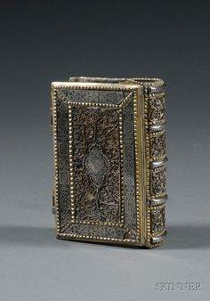 Galician Silver, Silver-gilt, Filigree, and Niello Book Binding, Krackow, early 19th century, tax stamp for Lwow (Lemberg), 1810-1824, rectangular form with applied niello panels, filigree, enamelwork, and a cartouche inscribed in Hebrew
