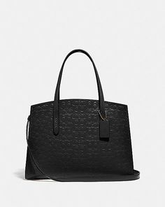 A study in everyday style, the Charlie Carryall is spacious in design and lightweight in feel. The Signature leather silhouette features an organized, thoughtful interior that's perfect from day to night. It fits a laptop. Designer Bags Sale, Womens Designer Bags, Designer Totes, Coach Leather Cleaner, Casual Bags, Bag Sale, Womens Tote Bags, Tote Handbags, Calf Leather