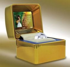 awesome ring box--when you open it it plays video or pictures of your choosing to go along with the event.  Wouldn't this be the coolest engagement ring box?!