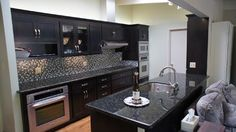 After photo / Wow, what a difference. The newly painted black cabinets tie the whole kitchen together.