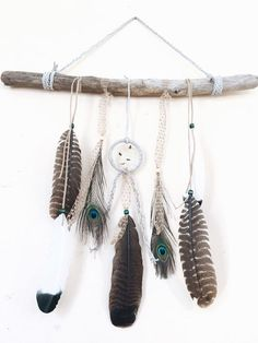 "The ultimate boho chic piece for any Gypsy Soul, adding a natural, rustic touch to any room decor! This handmade piece features a 3"" white leather dreamcatcher with beautiful stones and a lovely mixture of wild turkey & peacock feathers with braided leather & tweed. And of course, a large piece of driftwood handpicked off the shores of Lake Erie. https://www.etsy.com/shop/FoundandFeathers"