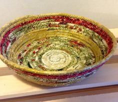 A personal favorite from my Etsy shop https://www.etsy.com/listing/260628525/fabric-pottery-coiled-fabric-bowl-basket