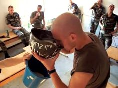 A French Foreign Legion tradition, apparently, to drink a helmet full of beer, then transfer it via puke to a nearby bucket.
