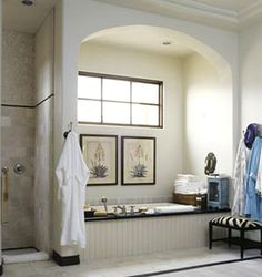 I love the calmness of this bathroom and the calming colors, but what I LOVE is the archway/window over the bathtub!