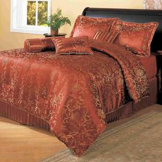 This luxurious Cassaria comforter features shades of red that will provide a very lavish look to your bedroom decor. This comforter set comes with a coordinated pillow, shams, Euro shams, and two accent pillows.