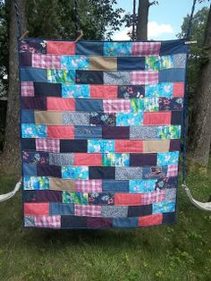 Memory quilt made completely of clothing, done in the subway tile pattern.