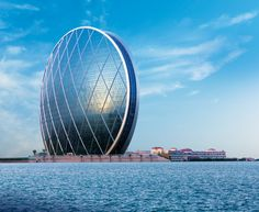 Hotel and Resorts Pool Ideas Interior Exterior Architecture. Incredible and Awesome Helix Hotel Abu Dhabi Style. Architecture Elegant Modern Helix Hotel Abu Dhabi Feature Unique Elegant Oval Blue Glass Patterned Shaped And Beautiful Background Sea View. Helix Hotel Abu Dhabi