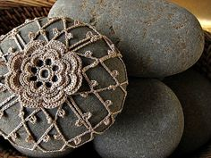 Flora crocheted beach stone - wow My mom use to do this , but over scented soaps, Very pretty on a dresser, or as a gift, in bathroom, on a vanity. Just use a stretchy elastic at bottom to put over. Also over plastic eggs, always. Lucky you if know how to crochet!