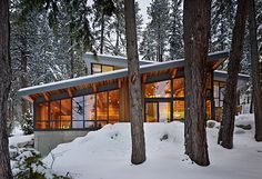 Seattle-based studio DeForest Architects has completed this two story mountain retreat. The contemporary residence sits on a lot overlooking the Lake Wenatchee in Washington State, USA 1