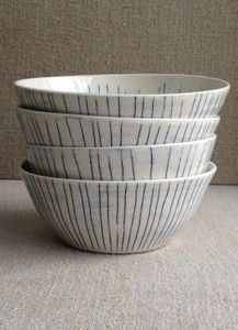 Paula Greif  Image of four blue striped porcelain dinner bowls / 2