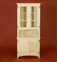 Gothic Cabinet Craft - American Pride Corner Cabinet with Two Raised Panel Doors and Two Glass Hutch Doors, $399.00 (http://www.gothiccabinetcraft.com/american-pride-corner-cabinet-with-two-raised-panel-doors-and-two-glass-hutch-doors/)